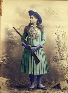"Sharpshooter Annie Oakley, born Phoebe Anne Oakley Moses, grew up on a farm in rural Darke County, Ohio, near Greenville. She learned how to shoot as a young girl, when she helped feed her family by shooting game in the surrounding forest. She entered a shooting contest in Cincinnati at the age of 17 and defeated her future husband, Frank Butler. From 1885 to 1902 Annie Oakley and Frank Butler toured with ""Buffalo Bill"" Cody's Wild West Show."