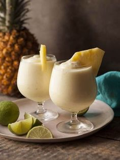 The Daiquiri will always remind me of vacations laying poolside or on the beach, toes in the sand. Ahhh, I can… Read more 4 Healthy-ish Daiquiri Recipes Refreshing Drinks, Summer Drinks, Fun Drinks, Mixed Drinks, Bebidas Com Rum, Frozen Pineapple, Cut Pineapple, Pineapple Drinks, Cocktail Recipes