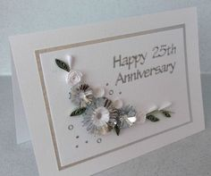 A beautiful handmade quilled card for a silver wedding anniversary, with quilling flowers in silver and white. Perfect for helping a special couple celebrate their memorable anniversary. Wedding Anniversary Greetings, Happy Anniversary Cards, Wedding Anniversary Invitations, Silver Anniversary, Paper Daisy, Wedding Cards Handmade, Etsy, Card Ideas, Wedding Gowns
