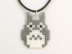 An adorable Totoro necklace, inspired by Studio Ghiblis My Neighbor Totoro!  Made using mini hama beads, black leather cord and silver-plated