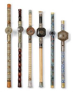 SIX CHINESE OPIUM PIPES 19TH CENTURY Modelled in ivory, bamboo, shagreen, bone, porcelain and cloisonn/ae enamel, with metal mounts and assorted bowls and end sections