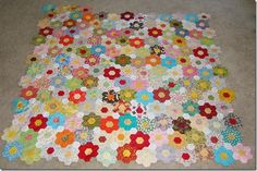 scrappy hexagon flower quilt... Definitely my next quilt!!!