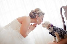 Bride leans in to kiss small dog before ceremony photographed by Kelly Kirkland Photography | Two Bright Lights :: Blog