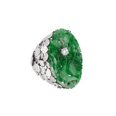 Lot 145 White Gold, Carved Jade and Diamond Ring, Andrew Grima 18 kt., one oval jade ap. 32.0 x 21.0 x 2.7 mm., signed Grima, ap. 11 dwt. Size 7 3/4. With signed box.
