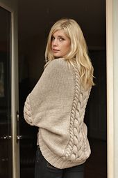 Inspiration. Crochet a big square with a large cable stitch up the middle, fold in half, stitch up short ends, leaving a space for arms near the folded end, add a cable stitch around arm openings and neck to create the look of a collar and sleeves.