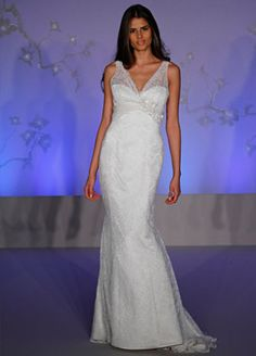 Style AV9052 > Bridal Gowns, Wedding Dresses > by Alvina Valenta (Shown Ivory Chantilly Lace soft Fluted gown with V-neckline front & back. Ivory Silk Chiffon ruching at Empire waist with Jewelled fabric Floral detail & Godets at sides & center back skirt)