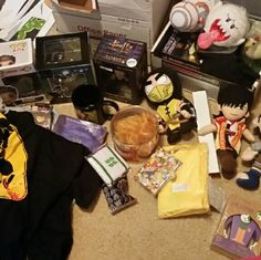 Loot crate loot Various items such as batman figure, joker doll, scorpion plush, pop figures, atari hat, zelda dashboard chicken, fallot and supernatural figures, a tribble plush, a pop iron man keychain, a max speed watch, an iron man mug, a buffy figure of spike, a promo disc of video game music, a video game, a titanfall knex set:all various prices just ask and i will make you a custom listing Other