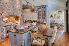 Country Kitchen with Glass panel, Custom hood, Kitchen island, Inset cabinets, Farmhouse sink, High ceiling, Wall sconce