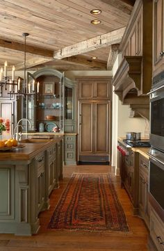 Match island to the cabinet and hutch in the dining room? Love this style runner too.