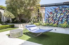 Art looks just as great in the garden as it does in the house. A hand-painted graffiti wall is the perfect ...