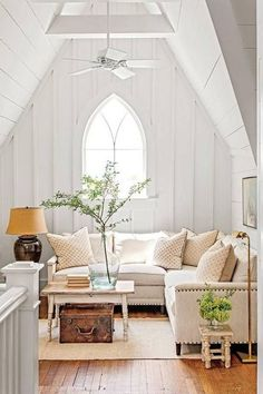 farmhouse interior white room with arched window