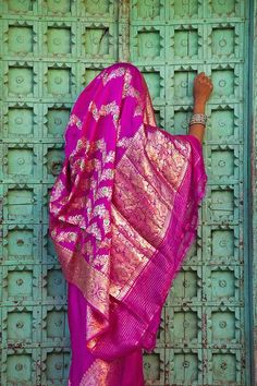 INDIA: - Woman in a pink saree at a turquoise door. Briliance of India in color. Bollywood, Indian Colours, We Are The World, Varanasi, World Of Color, India Travel, Op Art, Belle Photo, Magenta