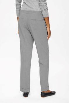 These trousers, in melange fabric, are a straight-leg style with turn-up cuffs. Designed to sit just below the waist and just above the ankle, they have slanted front pockets and a classic zip fly fastening.
