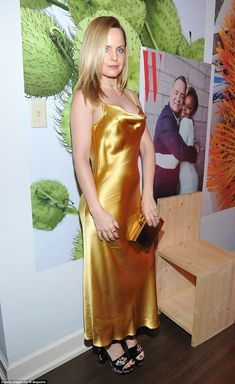 Shining: Mena Suvari showed off her fantastic figure with a mustard yellow strappy satin d...
