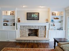 Fireplace updated with new ledger stone surround, custom built-in bookcases, lower storage, crown molding and new mantle.
