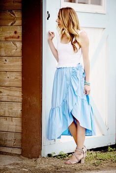 the motherchic wearing ruffle wrap skirt and cropped tank from anthropologie