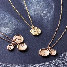 Wax Seal Horoscope Necklace. A unique cluster necklace designed with a mix of horoscope constellation and star sign wax seal charms. A bespoke and individual piece of astrological jewellery.