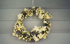 Using inexpensive fake flowers and foam bubbles to make my own summer wreath! #craft #micheals #makeityourself #yellow
