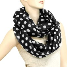 """We love the look of fun polka dots and it's even better on an infinity scarf! We kicked it up a notch to make this one in big bold dots!  Measures 34"""" x 74"""" 1"""