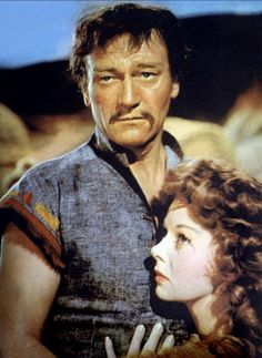 THE CONQUERER - John Wayne as 'Genghis Khan' with Susan Hayward - Directed by Dick Powell - RKO-Radio - Publicity Still.