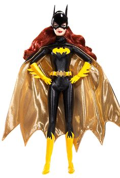 "Batgirl Barbie doll Barbie loves pop culture  Pink Label® Designed by: Bill Greening Release Date: 7/1/2008 Product Code: L9630 Barbie® doll as Batgirl™ looks absolutely amazing in a body-hugging black bat suit. A striking black cape with ""gold"" lining, yellow gloves, belt, knee-high boots, and fabulous ""bat ears"" complement the ensemble. Gorgeous face paint and long auburn hair give the doll an especially striking look."