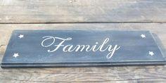 Wood signs with words on them like Faith, Love, Joy, Family