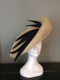 Stunningly shaped natural sinamay trimmed with hand made navy blue satin spikes. Absolutely perfect to finish a race day or wedding outfit. Sombreros Fascinator, Fascinator Hats, Fascinators, Headpieces, Fancy Hats, Cool Hats, Chapeau Trilby, Satin Bleu, Blue Satin