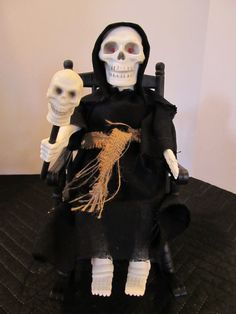 """The Grim Reaper in a rocking chair. A lazy Grim Reaper. The big """"Halloween Factory"""" emblem on the box means its a Gemmy product. Its from 1995, 11"""" tall and runs on 3-AA batteries. Get your butt up, theres work to do."""