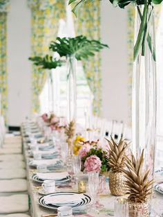bridal shower kings table with palm trees, gold pineapples and patterned linens http://itgirlweddings.com/bridal-tea-at-the-greenbrier/