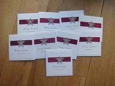 Winter snowfake wedding invitation with a large crystal snowflake embellishment. Shown in burgundy red