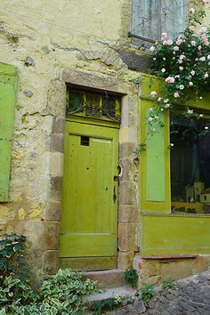chartreuse trim on charming centuries-old home...?France? or shop? `