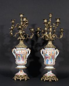 Pair of bronze candlesticks, 10 arms, with Canton porcelain body, late 19th century, h. 78 cm., some