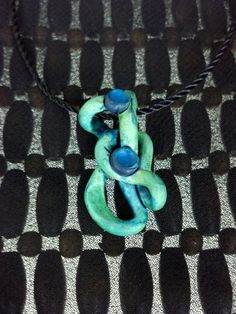 Hand-crafted polymer clay pendant with an acrylic wash by the Wifelette (lightwaterideations) for sale on Etsy.