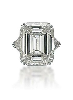 A DIAMOND RING, BY HARRY WINSTON  Set with a cut-cornered rectangular-cut diamond, weighing approximately 16.49 carats, to the triangular-cut diamond shoulders, mounted in platinum, ring size 5¾, in black suede Harry Winston case With maker's mark of Jacques Timey for Harry Winston