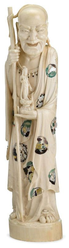 Tall & Impressive Japanese Shibayama & Ivory Okimono, solid standing immortal grasping staff with statue of Kannon at waist, raised on solid circular base applied to show various roundels to body.