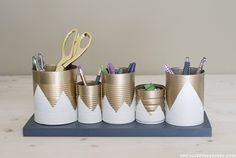 Tin cans are having a moment—make that moment your own. Upcycled Treasure's tin can office organizer is not just super cute, but also super easy to make. The only problem? Waiting for the paint to dry!