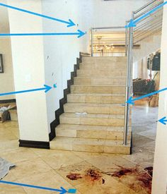 New crime scene photos have been released from Oscar Pistorius' home where he shot Reeva Steenkamp on February 14, 2013.  This photo shows blood at the bottom of the stairs and trailed down the stair case.