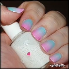 easy diy nails you just paint a white base coat, then get a triangle makeup sponge. paint the colors you want to blend, and dab it on your nail several times.