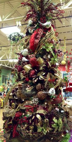 #Christmas burgundy, gold and brown tree. At Arcadia Floral & Home Decor showroom