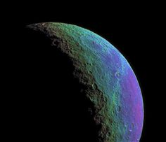 Cracked surface of Saturn's moon Rhea.
