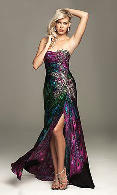 Bold beautiful colors and sparkling beaded accents create a sensational long prom dress for prom 2011