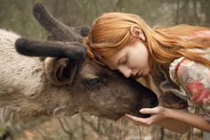 Harmony with nature in the portraits of girls with wild animals 14
