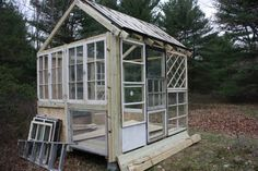 beautiful little shed made from recycled windows! we could TOTALLY do this for a cat enclosure. they would love having all that glass to watch the birdies and squirrels! WE ARE DOING THIS.