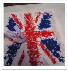 DIY Flag t-shirt with crayons.  Cut out a pattern from white paper.  Put some cardboard in between the layers of your clothing item to be colored. Use a pencil sharpener to shave the crayons over the portion you want to color, cover with an old rag and some wax paper, and iron the crayons until they are completely melted.