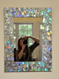 Broken CD's are used for a mosaic design on a mirror frame - easy diy!