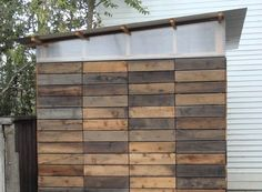 Oh, now I get it!  Frame the wall with standard techniques, then veneer with reclaimed wood.  Like the clerestory construction.  Petaluma Studio/Shed 2