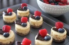 Light, bite-sized cheesecakes with fresh berries and rich dark chocolate.