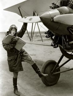 "1929...Actress Dorothy Sebastian goofs around with a prop, referring to book labeled ""How to Fly an Airplane."""