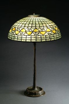 Lamp by Tiffany Studios with acorn patterned geometric shade.