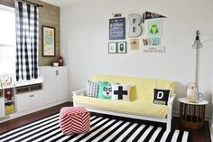 Colorful Camp Themed Playroom - love the bold colors and clever storage!